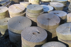 SMALL ANTIQUE MILLSTONES